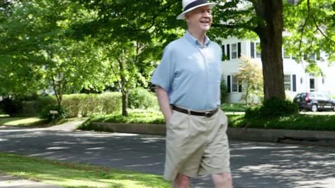 Senior man walking in neighborhood Stock Video Footage