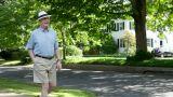 Senior man walking in neighborhood Footage