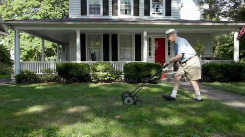 Senior man mowing front lawn Stock Video Footage