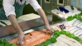 Woman getting fish from fishmonger Footage