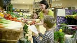 Mother and children getting tomatoes at supermarket Footage