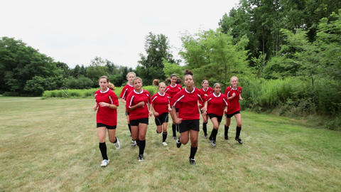 Girl soccer players running in field Stock Video Footage