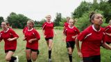 Girl soccer players running in field Footage