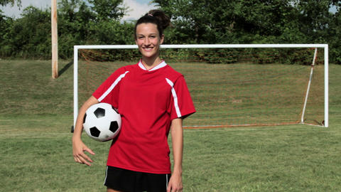Girl soccer player throwing ball Stock Video Footage