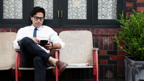 Businessman sitting outside cafe Stock Video Footage