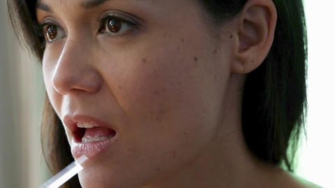Close up of young woman applying lip gloss Stock Video Footage