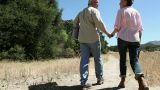 Rear view of couple walking on rural path Footage