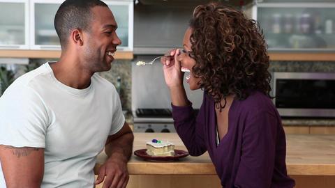 Woman teasing boyfriend and feeding him cake Stock Video Footage