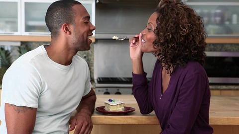 Woman teasing boyfriend and feeding him cake Stock Video Footage