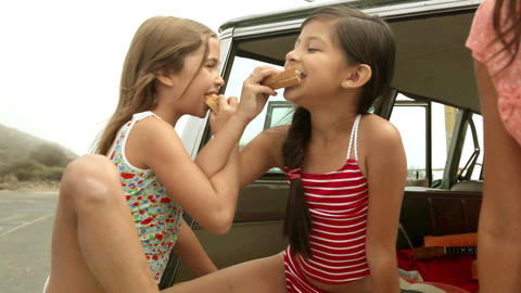 Two girls eating sandwiches Stock Video Footage