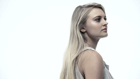 Rotating portrait of a young blond woman Stock Video Footage