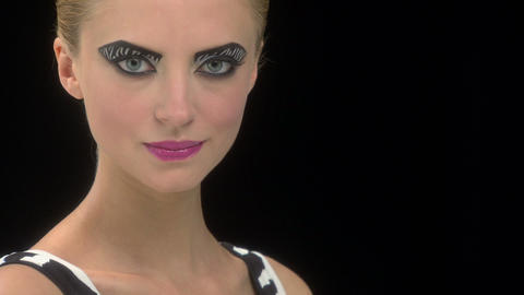 Camera moves to reveal young woman with zebra stripe eye... Stock Video Footage