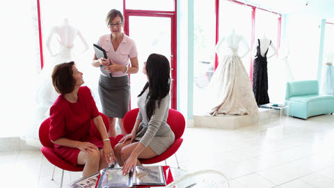 Mother and daughter talking to fashion designer Stock Video Footage