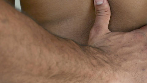Man massaging woman's back Stock Video Footage