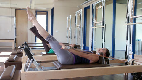 Two women doing pilates Stock Video Footage