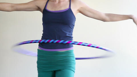 Woman doing pilates, spinning with plastic hoop Stock Video Footage