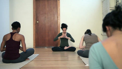Women practicing yoga with instructor Stock Video Footage