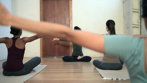 Women practicing yoga with instructor Footage