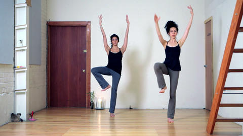 Two women practicing yoga Stock Video Footage