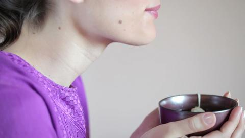 Woman drinking herbal tea Stock Video Footage