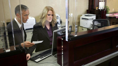 Two colleagues working in bank Stock Video Footage