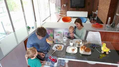 Family eating breakfast Stock Video Footage