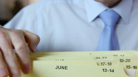 Office worker filing document Stock Video Footage