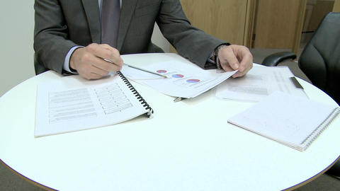 Businessman explaining pie charts Live Action