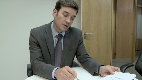 Businessman explaining pie charts Stock Video Footage