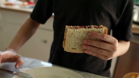 Boy eating sandwich Stock Video Footage