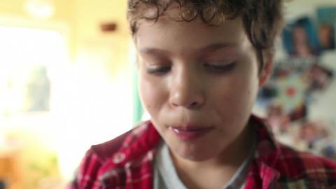 Boy drinking glass of orange juice Stock Video Footage