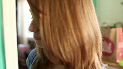 Teenage girl eating slice of apple Stock Video Footage