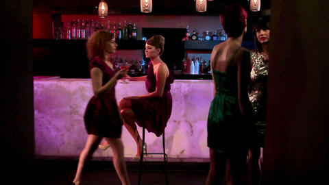 Woman sitting at cocktail bar Stock Video Footage