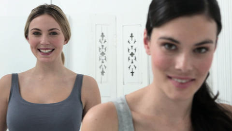 Portait of two young women in bathroom Stock Video Footage