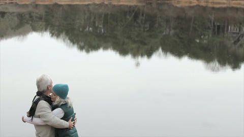 Loving mature couple by lake Stock Video Footage