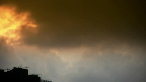 Clouds cover sun sky,building high-rise,House... Stock Video Footage
