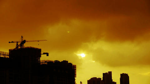 Clouds cover sun sky,building high-rise,House silhouette,sunrise,sunset Footage