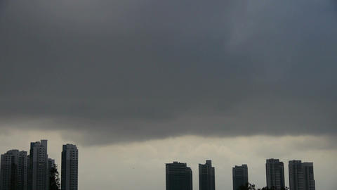 Dark clouds cover sun sky,building high-rise,House... Stock Video Footage