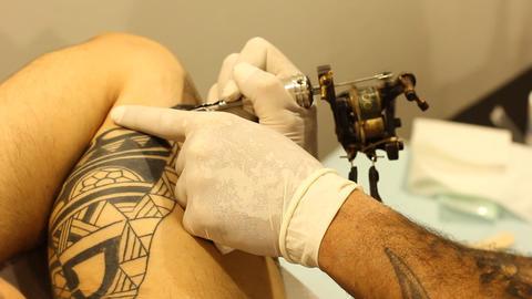 Tattoo shop tattooing pain artists body art skin needle... Stock Video Footage