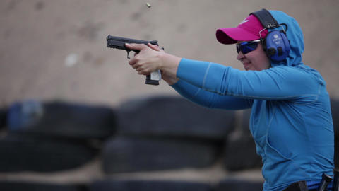 girl and a gun Stock Video Footage
