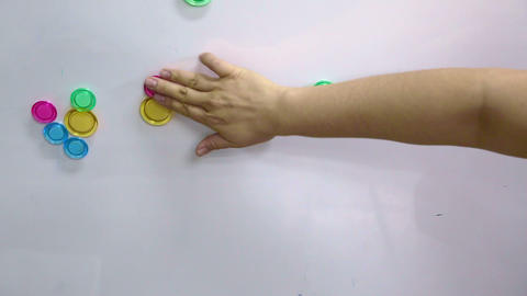 hand categorise colourful magnet on magnetic board Footage