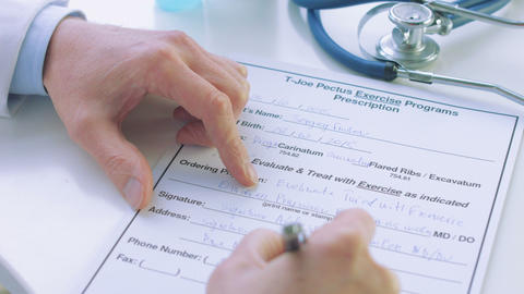 Close Up Of Male Doctor Hand Writing Prescription stock footage