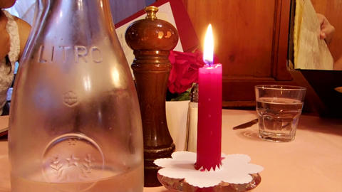 Red Candle at dinning table with black pepper Footage