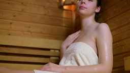 Relaxing Woman In Hot Sauna stock footage