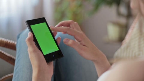 Woman hands touching, scrolling, zoom in, zoom out smartphone.green screen displ Footage