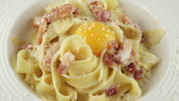 pasta carbonara with parmesan, egg yolk and bacon, closeup Footage