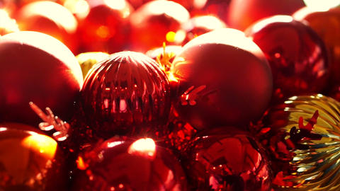 Close up, Shiny red and gold Christmas ball mistletoe ornaments in morning new y Footage