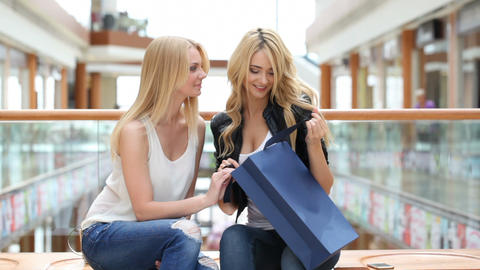 Women looking into shopping bags Footage