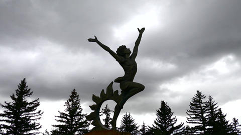 Dancing Statue with Dark Clouds Footage
