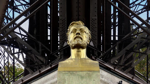 Monument (bust) Alexander Gustave Eiffel at the Eiffel Tower in Paris. 4K Live Action